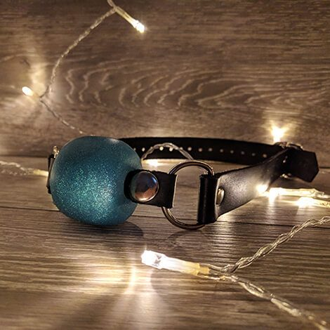 Godemiche Silicone Ball gag turquoise twinkly lights wood floor