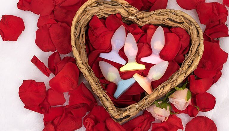 Godemiche Silicone DIldo Plug-B Pastel Hearts Collection on rose petals in a wicker heart shaped basket