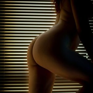 naked body in the window with blinds shut